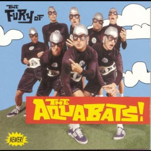 Travis with his pre-blink band The Aquabats. Can you guess which one he is?...