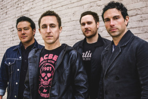 Yellowcard. L - R: Sean Mackin (Violin), Ryan Key (Vocals/Guitar), Ryan Mendez (Guitar), Josh Portman (Bass)